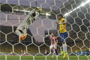 Brazil's goalkeeper Julio Cesar catches a ball during the Group A football match against Croatia at the Corinthians Arena in Sao Paulo during the 2014 FIFA World Cup