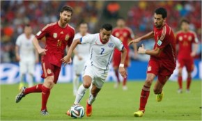 Chile's Forward Alexis Sanchez Charges Forward Against Spain