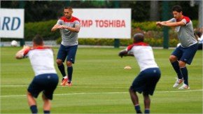 Clint Dempsey and Omar Gonzalez stretch during their training session at Sao Paulo FC