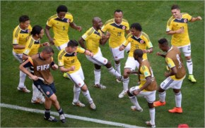 Colombia's players dance as they celebrate scoring during a Group C football match between Colombia and Ivory Coast at the Mane Garrincha National Stadium in Brasilia during the 2014 FIFA World Cup