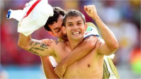 Cristian Gamboa of Costa Rica, at front, celebrates with Michael Barrantes after defeating Italy 2014 FIFA World Cup Brazil.