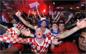 Croatian football fans react as they watch the opening match of the 2014 FIFA World Cup