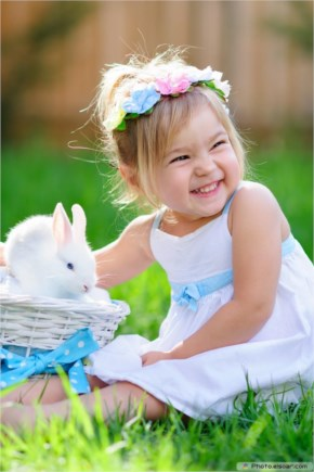Cute girl with a rabbit