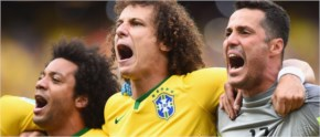 David Luiz of Brazil, in the center, sings the National Anthem with Marcelo and Julio Cesar before the 2014 FIFA World Cup Brazil