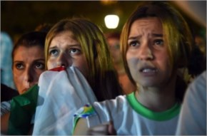Disappointed fans of Alergia react during a public screening 2014 FIFA World Cup
