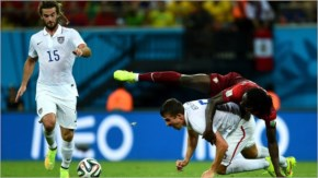 Eder of Portugal and Matt Besler of the United States compete for the ball