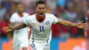Eduardo Vargas of Chile celebrates scoring his team's first goal during the 2014 FIFA World Cup Brazil