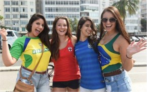 England supporter Caz Crayford (second left) with female Brazilian fans in Rio de Janeiro, all in the World Cup uniform of tiny shorts