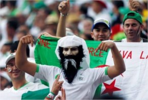 Fans of Algeria, one wearing a mask, cheer before the group H World Cup soccer