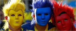 Fans of France kiss before their 2014 World Cup