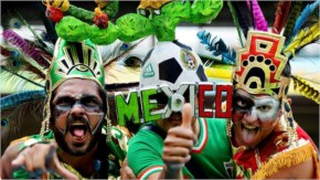 Fans of Mexico pose prior to the 2014 FIFA World Cup Brazil