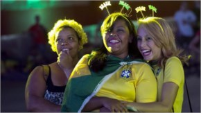 Fans of the Brazilian football team cheer before watching their match against Cameroon in the FIFA Fan Fest in Belo Horizonte, Brazil.