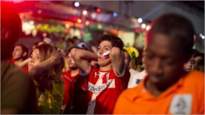 Fans of the Chile football team watch their team lose to the Netherlands on a big screen in the FIFA Fan Fest in Belo Horizonte, Brazil.