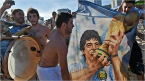 Fans react after Argentina's victory in their quarter-final match against Belgium at Copacabana Beach in Rio de Janeiro FIFA World Cup in Brazil