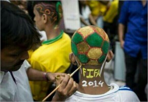 FIFA World Cup A hairstylist applies color on the hair of a soccer fan after the haircut inside a saloon