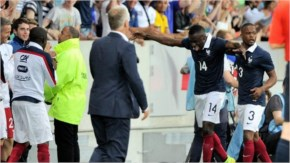 France's midfielder Blaise Matuidi (C) celebrates after scoring