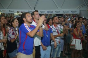 French and Nigerian Soccer fans in Dubai cheer their teams on at the Brazil World Cup 2014 arena in Barasti, Dubai as the two teams go head to head in Brazil