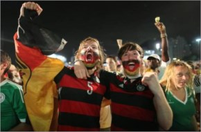 Germany soccer fans celebrate a goal as they watch their team's World Cup FIFA Fan Fest
