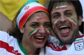 Iranian fans cheer for their team before the start of the Group F match between Iran and Nigeria at the Baixada Arena in Curitiba during the 2014 FIFA World Cup