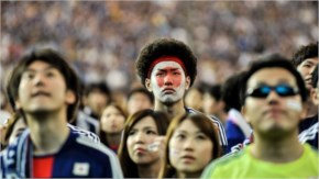Japanese fans react after Japan is defeated during the 2014 FIFA World Cup