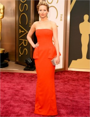 Jennifer Lawrence is wearing an orange colored gown from Dior