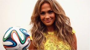 Jennifer Lopez poses with the official matchball Brazuca