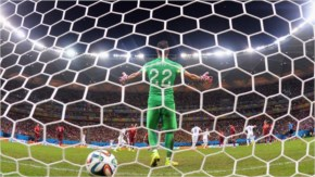 Jermaine Jones of the United States scores the team's first goal past Beto of Portugal