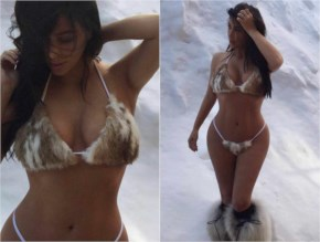 Kim Kardashian poses in the snow in a fur bikini