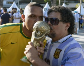 Look alikes of Brazilian and Argentine legends Maradona and Ronaldo. With the World Cup in hand