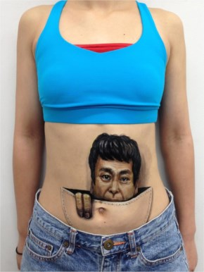 Man in stomach awesome body painting