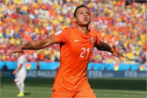 Memphis Depay of the Netherlands celebrates scoring his team's second goal during the 2014 FIFA World Cup Brazil