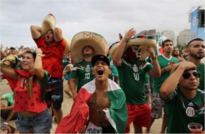 Mexico soccer fan Jose Reyna, center, reacts as he watches his team's World Cup match with Cameroon inside the FIFA Fan fest area on Copacabana beach in Rio de Janeiro, Brazil
