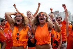 Netherland Soccer Fans React As Their Team Scores Their Second Goal Against Chille As They Watch On A Screen Setl The FIFA Fan Fest