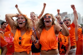 Netherlands soccer fans react as their team scores their second goal against Chile while watching on a screen set up at the FIFA Fan Fest Brazil.