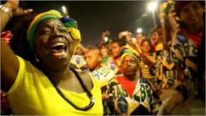 Ojuoba Axe band members perform and celebrate after Brazil defeated Cameroon along Copacabana Beach in Rio de Janeiro, Brazil.