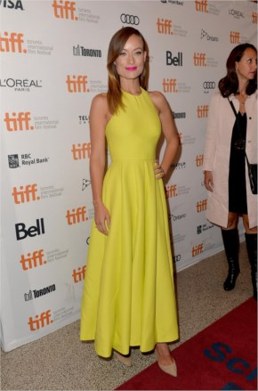 Olivia Wilde in bright yellow halter gown at the premiere
