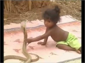 Only In India, they use cobra as toys for their kids