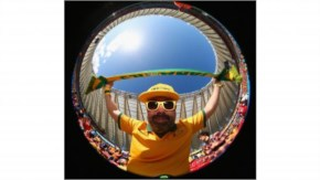 Photographed with a fish-eye lens, an Australia fan shows his excitement prior to the 2014 FIFA World Cup Brazil