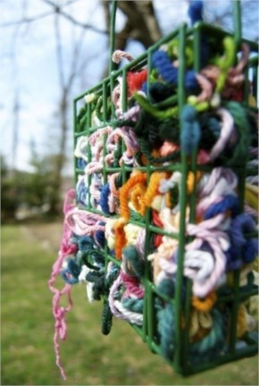 Place scraps of yarn in a suet feeder and birds will use them to make their nests.