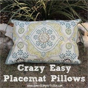 Placemats + fabric waterproofing spray = cheap and easy outdoor throw pillows.