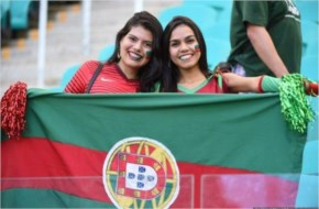 Portugal fans pose prior to the Group G football match between Germany and Portugal at the Fonte Nova Arena in Salvador during the 2014 FIFA World Cup