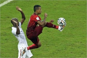 Portugal's Nani controls a ball as United States' DaMarcus Beasley looks on
