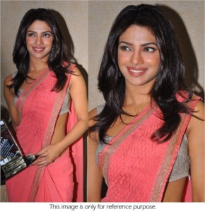 priyanka chopra looks hot in pink saree showing award after wining best acress award