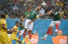 Rafael Marquez  and Javier Hernandez of Mexico go for a header during the FIFA World Cup 2014