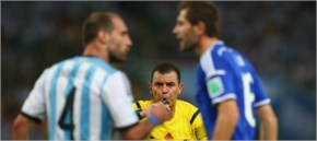 Referee Joel Aguilar reacts as Pablo Zabaleta of Argentina, at left, and Senad Lulic of Bosnia and Herzegovina clash during the 2014 FIFA World Cup Brazil