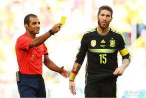 Sergio Ramos of Spain is shown a yellow card by referee Nawaf Shukralla during the 2014 FIFA World Cup Brazil