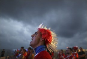 Soccer fan wearing a Mohawk-styled wig in Chile's team colors