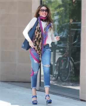 Sofia Vergara Street Style | playful scarf and ripped jeans and wearing six inch heels gallops through LA