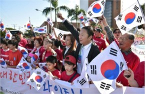 South Korean fans wave their national flag as they welcome their national football team at the Bourbon Hotel in Foz do Iguacu, Parana, Brazil