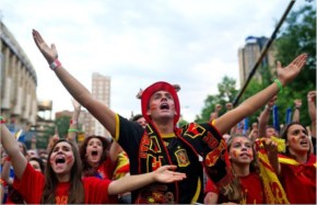 Spanish soccer fans watch as their team plays against the Netherlands on the giant screen showing the FIFA World Cup